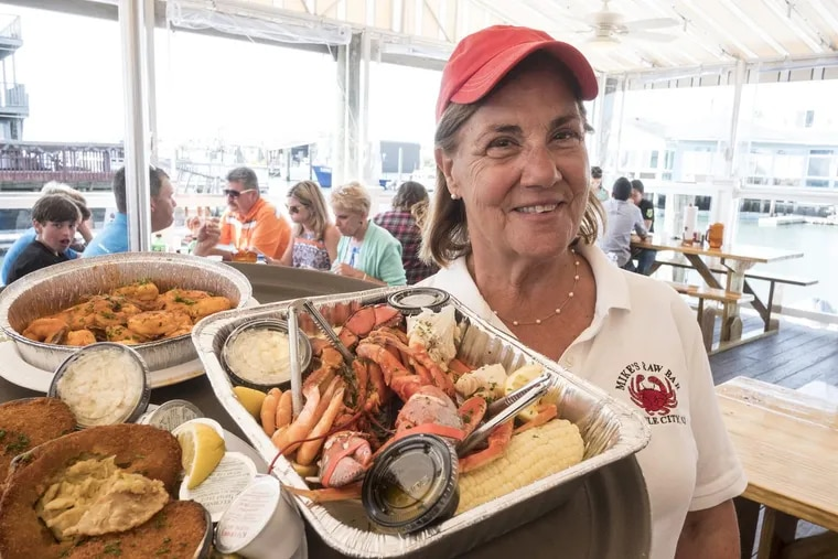 Rosemary Deery with an order of seafood at Mikes Seafood and market in Sea Isle City. ED HILLE / Staff Photographer