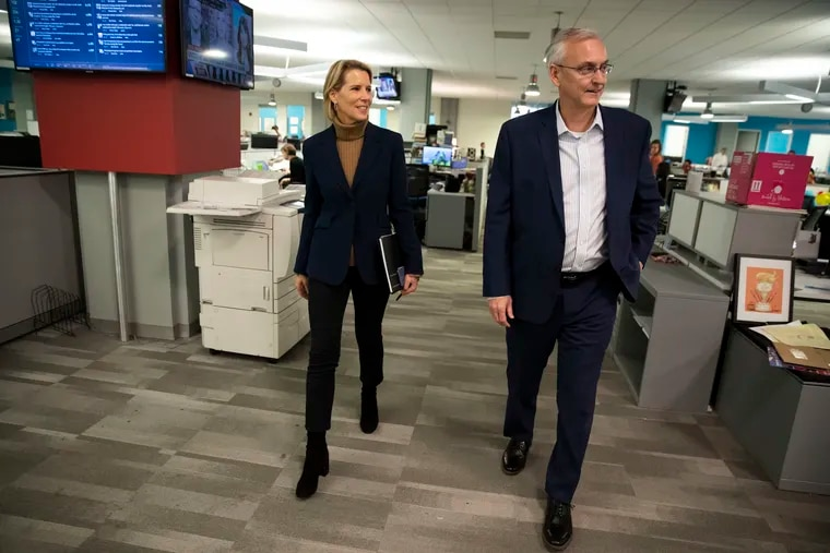 Stan Wischnowski, executive editor and senior vice president of the Philadelphia Inquirer, takes new publisher Lisa Hughes on a newsroom tour Feb. 3, 2020.