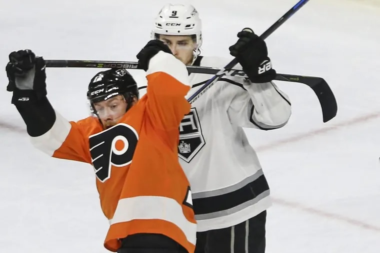 The Flyers' Michael Raffl tangles with the Kings' Adrian Kempe during the second period at the Wells Fargo Center.