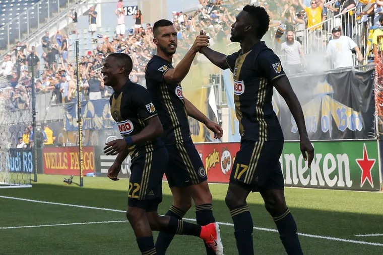 Haris Medunjanin (center) delivered two assists in the Philadelphia Union's win over the New England Revolution.