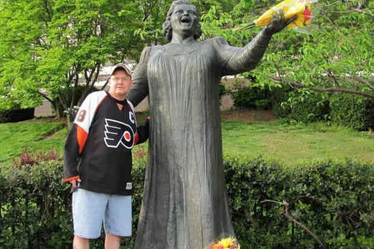 Ed Slivak of the Summerdale section of the Northeast and a lifelong Flyers fan, visits the Kate Smith statue outside the Spectrum. He always asks her for help, he says.