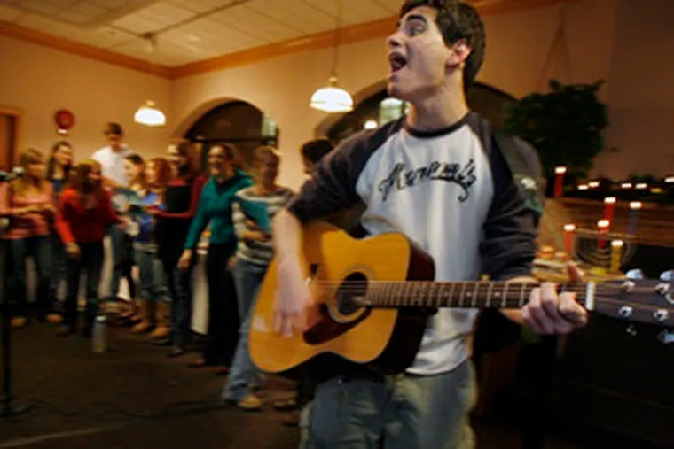 Muhlenberg College student Stephen Brickman sings during the school's Hanukkah celebration. The small Lutheran college in Allentown has the 10th-largest percentage of Jews among U.S. colleges.