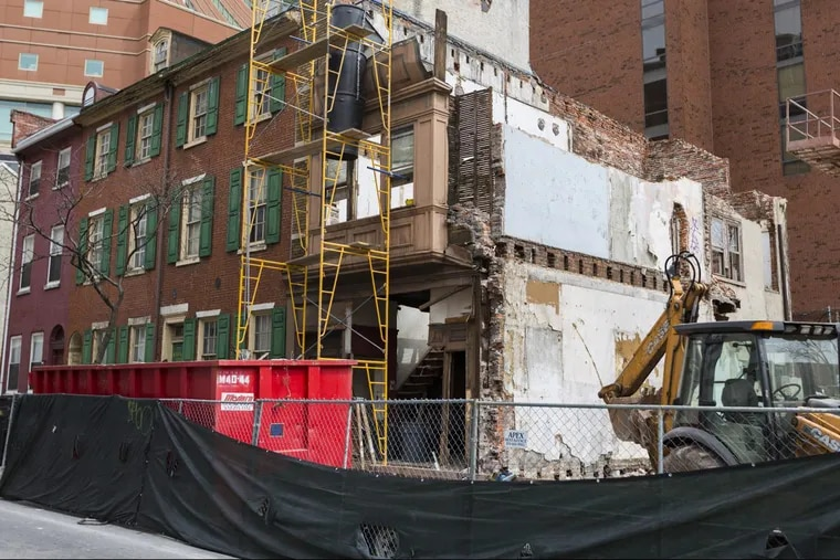 The weaknesses of Philadelphia's preservation law can be seen in Wills Eye Hospital's treatment of a row of 19th-century houses on Ninth Street. Wills has badly neglected all five houses, including three listed on the historic register. The demolition of the two at the end (which are not designated) seems to be the first step in creating a site for a new building.
