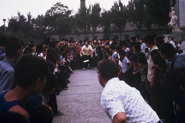 08-Frisbee-1973 Philadelphia Orchestra musicians teach Frisbee to a crowd during the 1973 Tour of China.