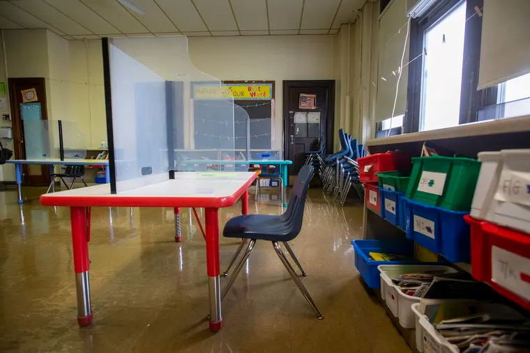 The first Philadelphia school has closed to in-person learning because of COVID-19. In this file photo, a city classroom is shown with plastic partitions for virus mitigation.