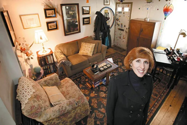 Cara Carroccia in the living room of her house on South Camac Street in Philadelphia.  (Laurence Kesterson / Staff Photographer)