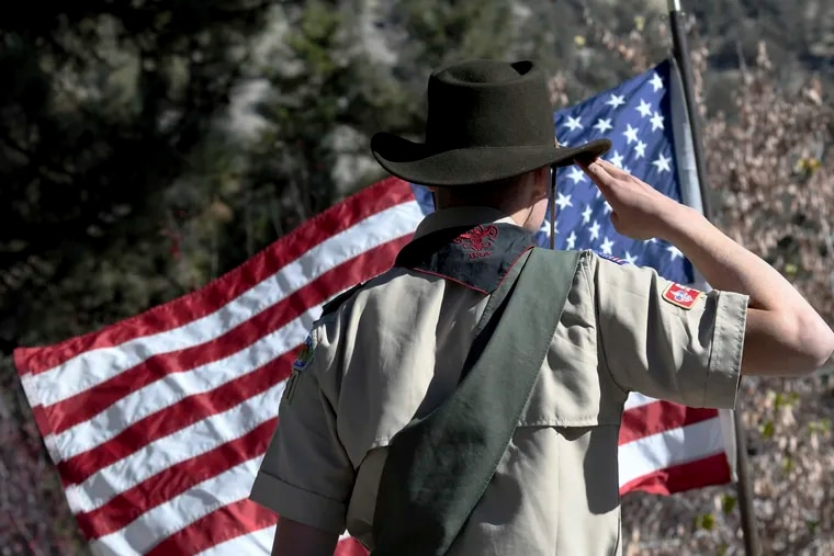 Boy Scouts lead the Pledge of Allegiance to begin a Veterans Day ceremony in Wrightwood, Calif., in2018. The Boy Scouts are now facing bankruptcy.