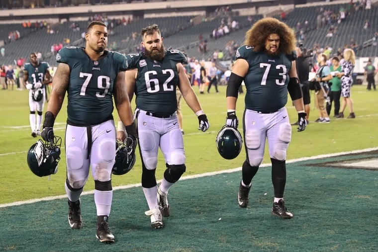 Brandon Brooks (left), Jason Kelce and Isaac Seumalo walk off the field after the Eagles lost to the Vikings earlier this season.