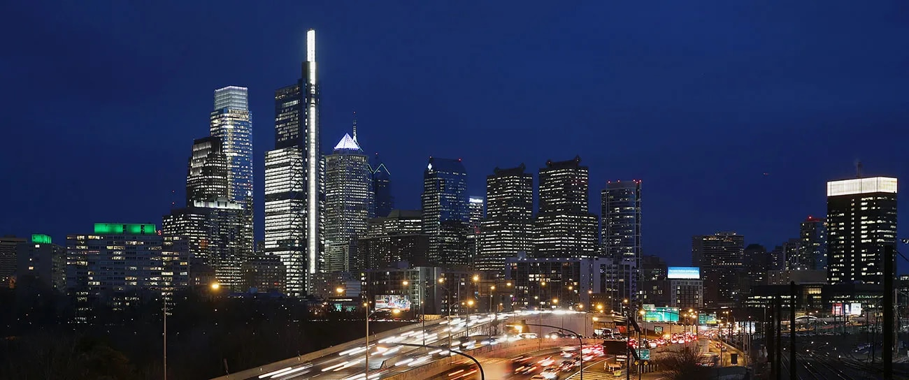 The Comcast Technology Center is pictured at dusk behind the Schuylkill Expressway in Center City.