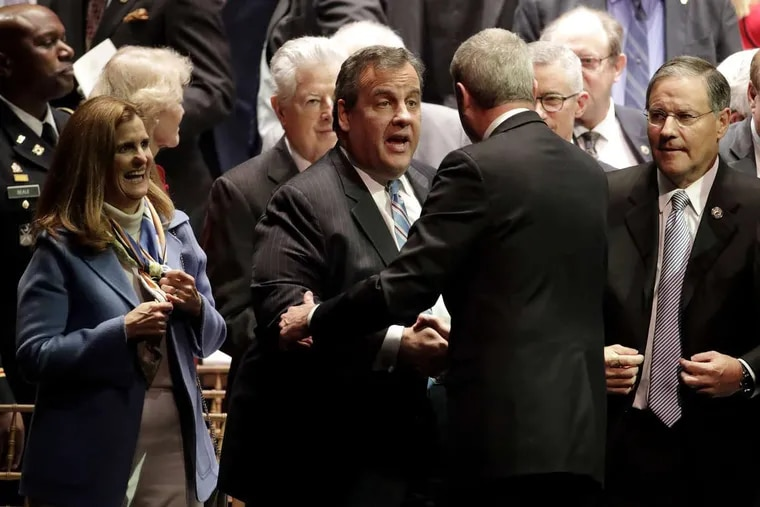 Former New Jersey Gov. Chris Christie (center left) turned over the state to  Gov. Phil Murphy (center right) on Tuesday.