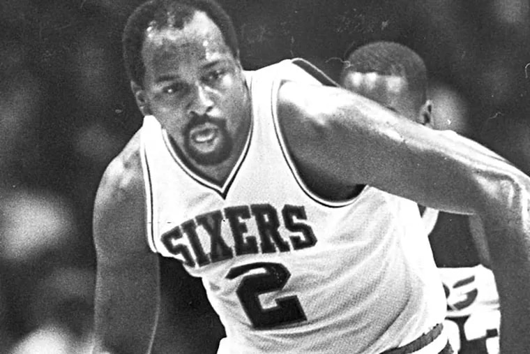 Moses Malone drives up court after a steal. (November 7, 1985)