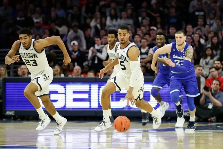 Phil Booth leads a fast-break with teammate Jermain Samuels (left) against Seton Hall in January.