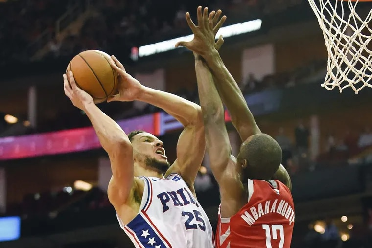 Philadelphia 76ers guard Ben Simmons, left, shoots as Houston Rockets forward Luc Mbah a Moute defends during the second half of an NBA basketball game, Monday, Oct. 30, 2017, in Houston. Philadelphia won 115-107. (AP Photo/Eric Christian Smith).
