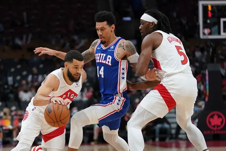 Toronto Raptors guard Fred VanVleet (left) moves around 76ers forward Danny Green (14) as teammate Precious Achiuwa (5) sets a pick during Monday's game.