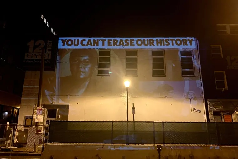 On Dec. 23, 2020, artist Michelle Angela Ortiz projected this image on 12th Street Gym, where her mural of Gloria Casarez was painted over.