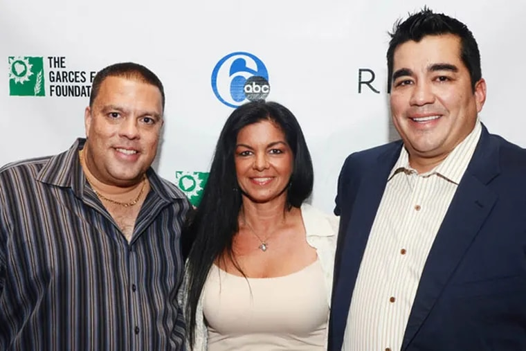 Former Wired 96.5 radio personality Chio Acosta and his wife, Shawn Acosta with Jose Garces.