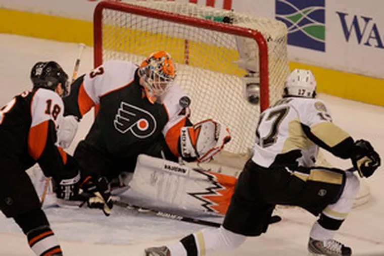 Martin Biron can't stop Petr Sykora's goal, which tied the game at 2 for the Pens. Joffrey Lupul scored or assisted on the Flyers' first six goals.