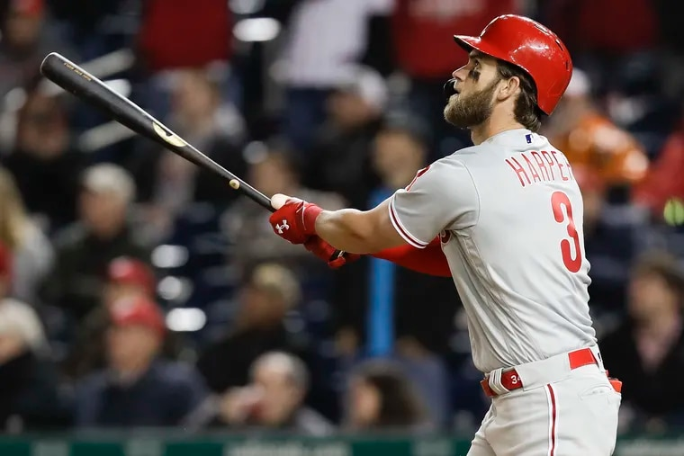 Phillies Bryce Harper watches his eighth-inning two run home run against the Washington Nationals on Tuesday, April 2, 2019 in Washington D.C.