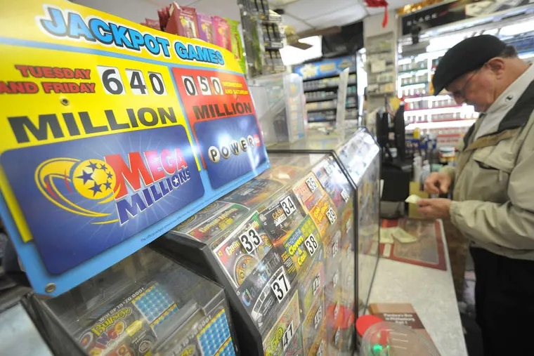 his Mega Millions ticket at Towne Market in Phillipsburg, N.J. The jackpot for Friday's drawing was up to $640 million Friday afternoon, or $462 million for the cash up front. MATT SMITH / The Express-Times