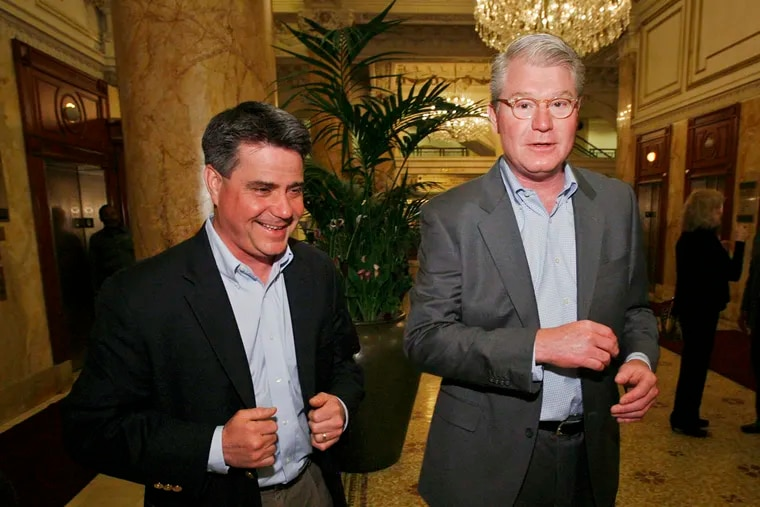 Philadelphia City Councilmember Bobby Henon (left) and union leader John J. Dougherty (right) attend a lunch at the Palm Restaurant at the Bellevue in Center City in this 2011 file photo. Starting Monday, the men will stand trial together accused in a federal bribery and corruption case.