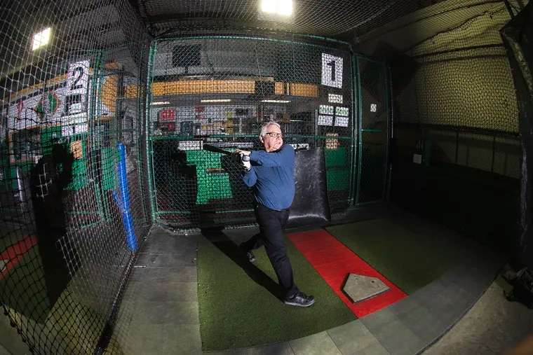 Judge Ben Lerner swings the bat at the Grand Slam USA batting cages in Malvern. Lerner, 78, still plays in an over-65 baseball league, and credits his late brother to getting him hitting.