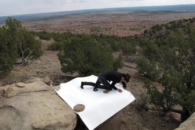 """Jill O'Bryan at work on one of her """"Rock Drawings"""" for her Gallery Joe exhibition."""
