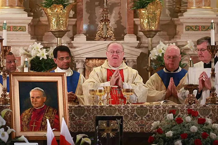 """Bishop Dennis Sullivan at St. Joseph's Church, a center of South Jersey's Polish community: """"We come to celebrate something of great joy and great importance: that we have two new saints."""" (David Swanson/Staff)"""