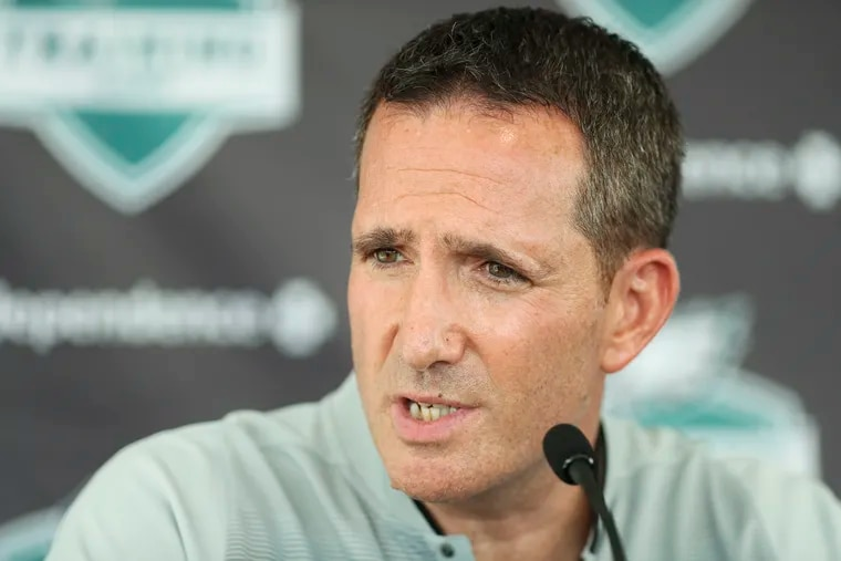 Philadelphia Eagles general manager Howie Roseman talks with reporters during the first day of Eagles training camp.