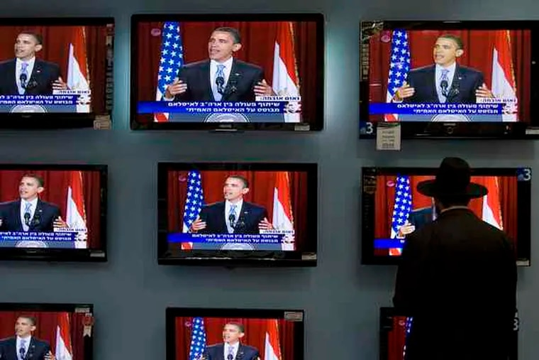 LEFT, TOP: An Orthodox Jew watches Obama's speech on TV screens in Jerusalem yesterday. LEFT, BOTTOM: Pakistanis listen to the speech, translated into Urdu, in Lahore.
