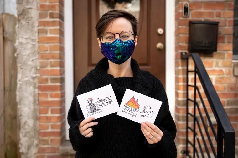 Kristin Everham, 35, of South Philadelphia, with her custom-made holiday cards.