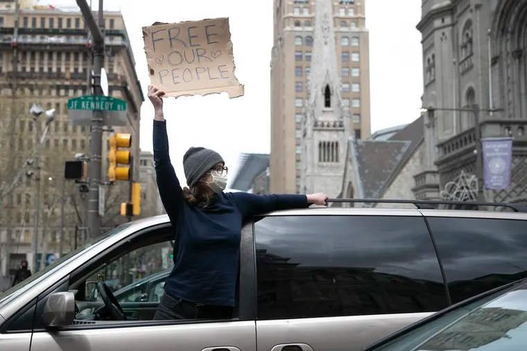 Protesters rally Friday outside of City Hall for the release of inmates amid a coronavirus outbreak in the Philadelphia jails. A new expedited court review process this week has led paved the way for hundreds of jail inmates to be released, but advocates say it's still not moving fast enough.