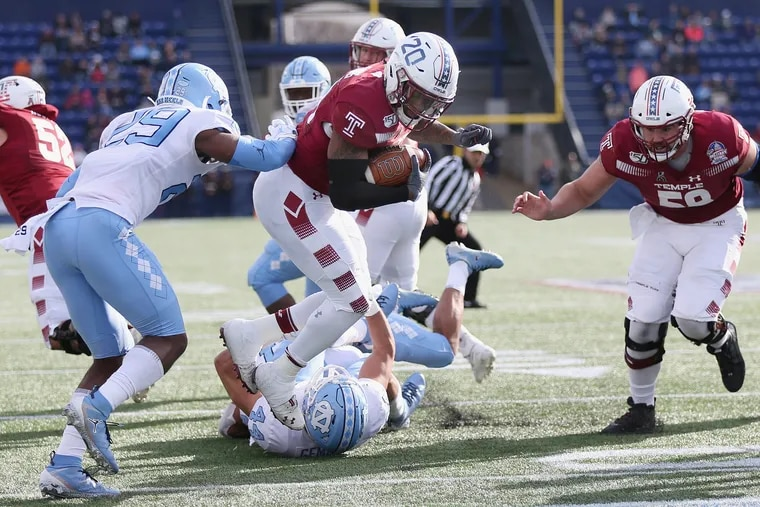 Temple running back Re'Mahn Davis (20) tumbles past North Carolina defensive back Storm Duck (29) into the end zone for a touchdown in the second quarter of the Military Bowl.