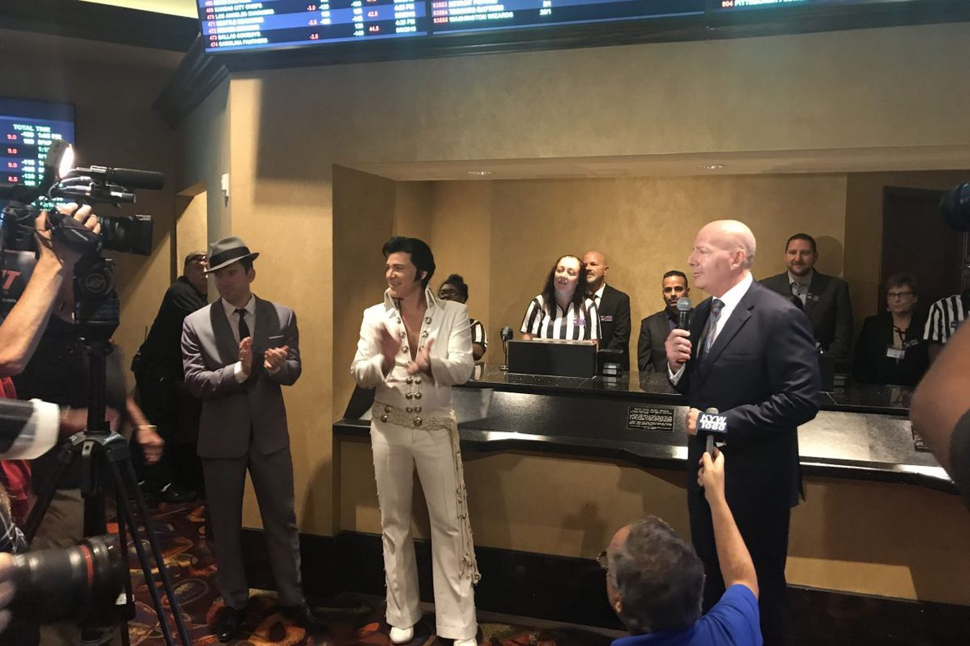 Elvis and Sinatra open Harrah's Atlantic City's sportsbook with an L
