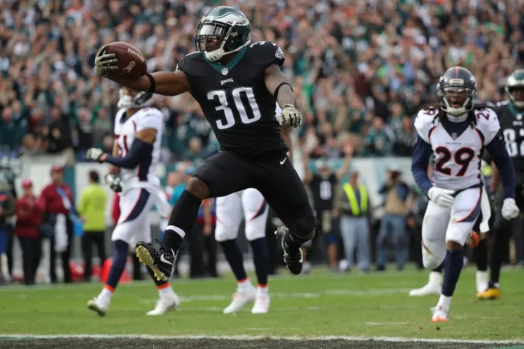Eagles' Corey Clement leaps into the end zone for a 1st quarter touchdown as the Philadelphia Eagles play the Denver Broncos in Philadelphia, PA on November 5, 2017. DAVID MAIALETTI / Staff Photographer
