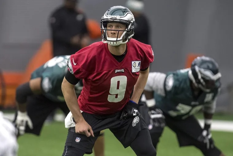 Starting quarterback Nick Foles during team stretching exercises at practice Wednesday.
