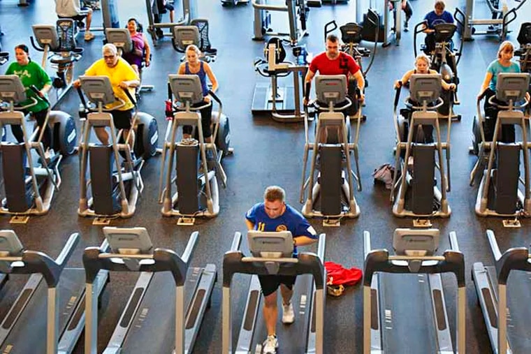 """Wednesday April 9, 2014 Built on the site of the old """"Swell"""" bubblegum factor, the brand new Haverford YMCA bills itself as the fastest growing Y in the nation. Here,  a mid-morning crowd of people exercise on the high-tech treadmills, stair climbers and other fitness machines. ( ED HILLE / Staff Photographer )"""