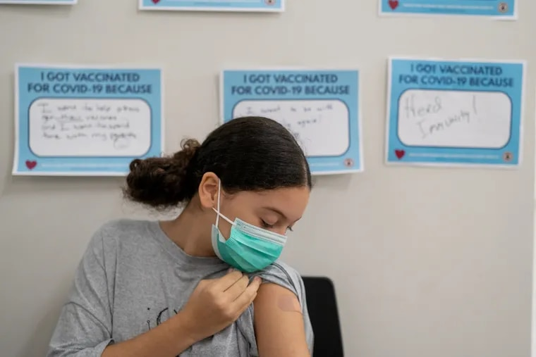 Maria Karen, 12, shows off her band aid after she was vaccinated at Delaware County Wellness Center earlier this month.