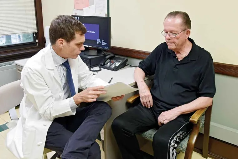 """Bill Lyon and his doctor Jason Karlawish, codirector of the Penn Memory Center. Lyon shows """"it's possible to be aware and to live well,"""" his doctor says."""