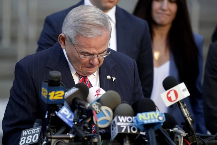 Sen. Bob Menendez fights tears Thursday while speaking to reporters outside Martin Luther King Jr. Federal Courthouse after U.S. District Judge William H. Walls declared a mistrial.