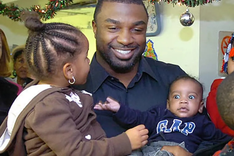 Brian Westbrook participated in a charity toy giveaway in West Philadelphia on Monday. He hasn't played a game for the Eagles since November 15. (Sarah J. Glover/Staff Photographer)