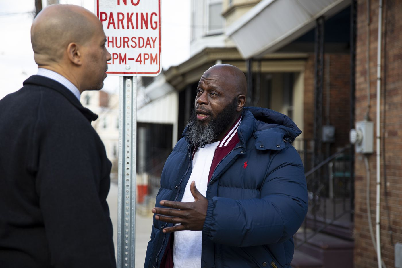 Cory Booker visits a Camden rowhouse to meet N.J. man released early from federal prison under new law