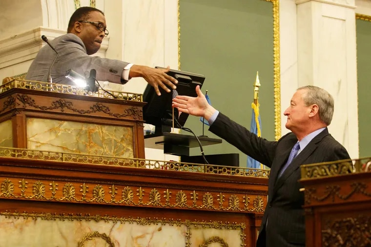 City Council President Darrell Clarke and Mayor Jim Kenney shake hands in City Council chambers.