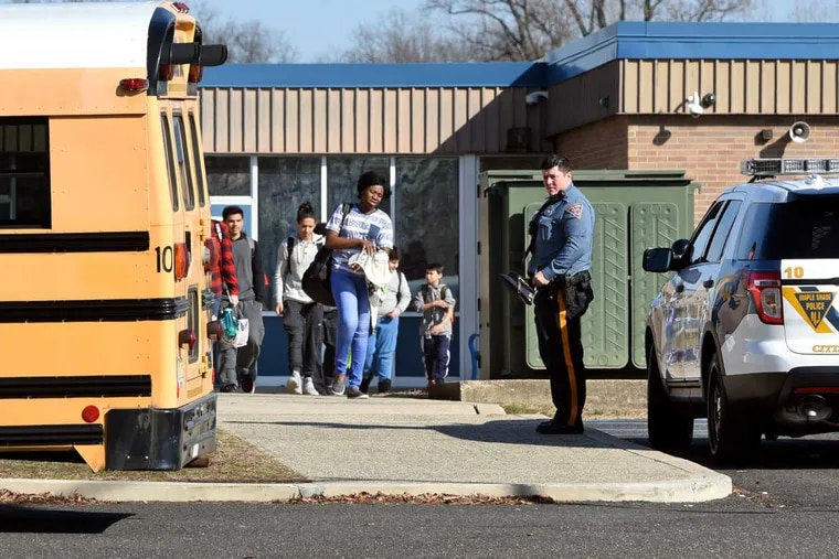 With a police presence, students leave Maple Shade High School on Tuesday, Feb. 20, 2018. Despite reports of students hurling racist taunts and racial epithets to classmates on social media, there was no evidence of student protests outside the school.