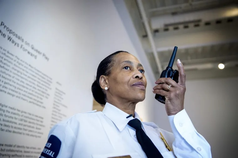 North Philly native Linda Harris, who has worked as a guard at the Institute of Contemporary Art in Philadelphia for 16 years, uses her radio to communicate with another guard in the museum.