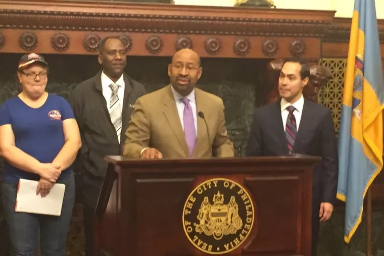 Mayor Nutter (podium) is joined by Julián Castro (right), secretary of the U.S. Department of Housing and Urban Development, and others at Thursday's news conference.