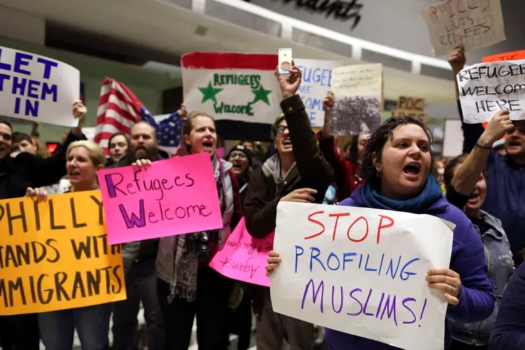 Protesters gathered at Philadelphia International Airport to rally against President Trump's executive order. Two Christian Syrian immigrant families were detained there despite having immigrant visas and green card approval. Story, A14. JOSEPH KACZMAREK