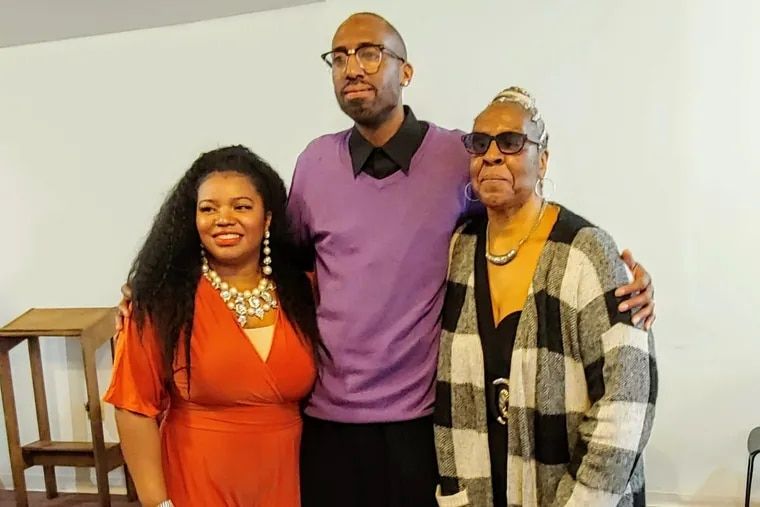 Shalena Broaster (left); Odell Johnson; and Johnson's mother, Regina Johnson, on March 19 at Highway Temple of Love in North Philadelphia, where Broaster and Johnson were married.