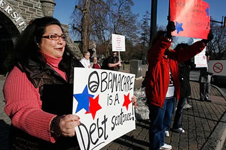 Mariann Davies, left, protests with members of Kitchen Table Patriots outside Arcadia University. (ALEJANDRO A. ALVAREZ / Staff Photographer)