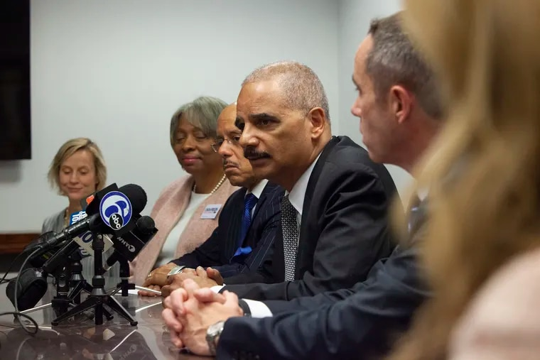 Former Attorney General Eric Holder, chair of the National Democratic Redistricting Committee, holds a press conference with state Senate candidates at the Law Offices of Ahmad Zaffarese in Center City on Thursday, Oct. 11, 2018. HEATHER KHALIFA / Staff Photographer