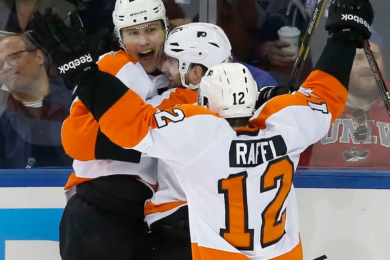 YONG KIM / STAFF PHOTOGRAPHER Luke Schenn is greeted by Andrew MacDonald and Michael Raffl after game-winning goal.